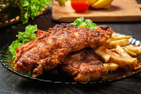 deep fry: Fried fish in crispy batter with chips on a plate