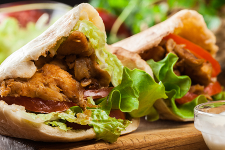 doner: Doner kebab - fried chicken meat with vegetables in pita bread