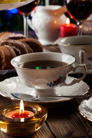 stand teapot: High tea set with dessert on festive table Stock Photo