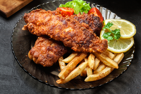 batter: Fried fish in crispy batter with chips on a plate