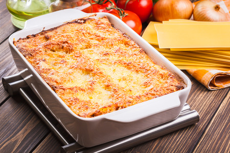 casserole dish: Hot tasty lasagna in ceramic casserole dish