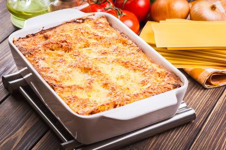 Hot tasty lasagna in ceramic casserole dish