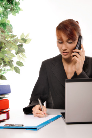 clr: Businesswoman talking on telephone