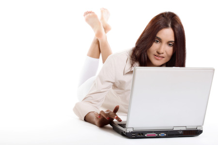 working woman: Young woman working with laptop Stock Photo