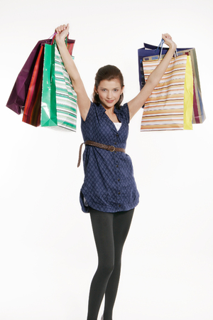 christmas spending: Young woman holding shopping bags Stock Photo