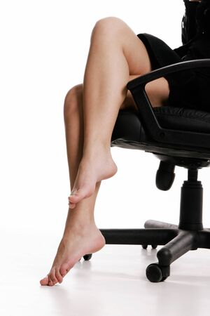 Businesswomans legs on white background