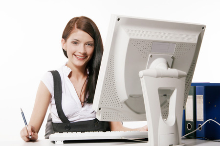 working on computer: Young woman working with computer