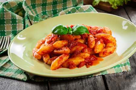 Italian gnocchi with tomato sauce on a plate