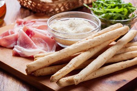 grissini: Traditional italian grissini with ham prosciutto, mozzarella and arugula Stock Photo