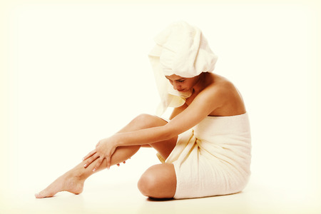 Alternative medicine and body treatment concept. Atractive  young woman after shower with towel.