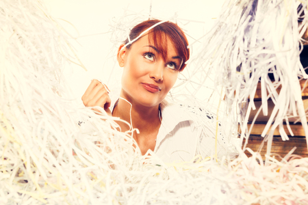 shredded paper: Ecology concept. Young woman with shredded paper. Focus on face. Toned image