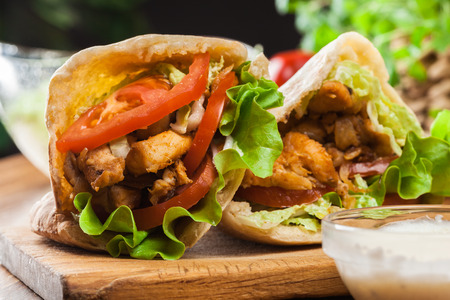 tzaziki: Doner kebab - fried chicken meat with vegetables in pita bread