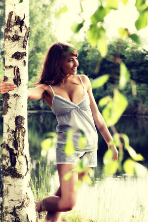 1 person: Attractive woman enjoying morning sun in the park. Relaxing concept