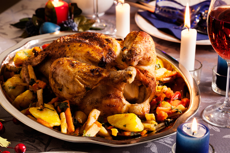 whole chicken: Baked whole chicken for Christmas dinner on festive table Stock Photo