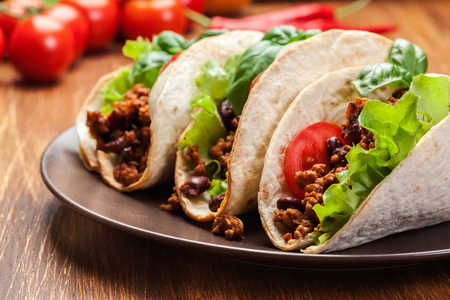 haricot: Mexican tacos with minced meat, beans and spices on a plate Stock Photo