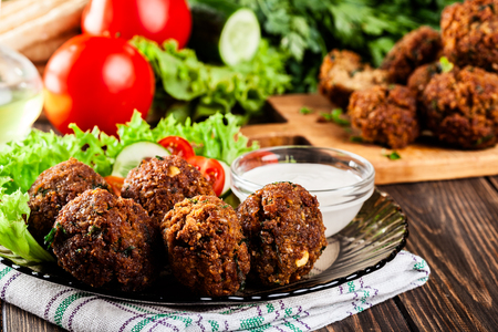 Chickpea falafel balls on a plate with vegetables Standard-Bild