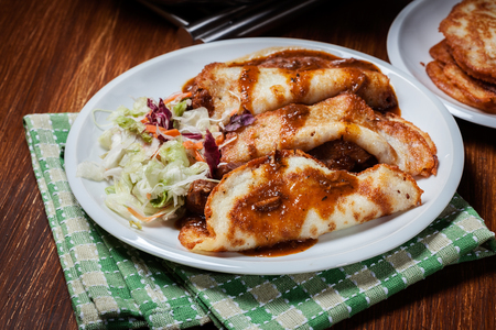 hungarian: Potato pancakes with meat stew served on a plate