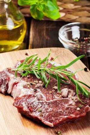 peppercorn: Raw beef steak on a cutting board Stock Photo