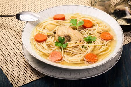 polish chicken: Fresh chicken broth with noodles and carrot