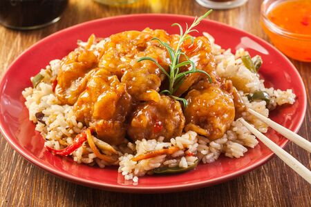 batters: Fried chicken pieces with rice and sweet and sour sauce