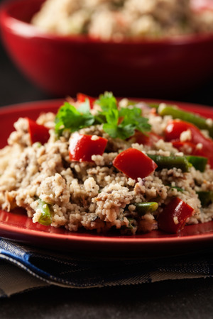 Salad couscous with tuna, bell pepper, cucumber, red onion and green beans on a plate Stock Photo