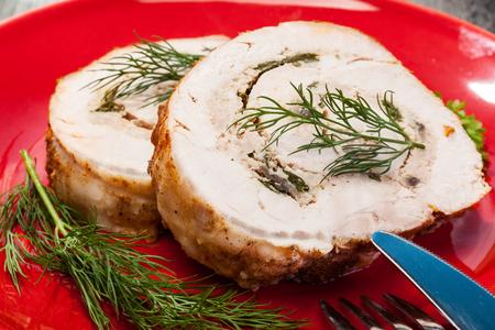 Sliced pork lion roll stuffed with mushrooms on a plate