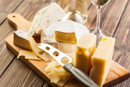 Set of different cheeses on a chopping board