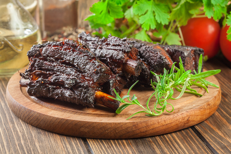 Baked pork spare ribs served on cutting board