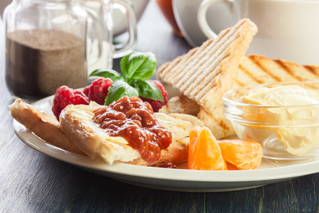 Fresh and continental breakfast table with jam on toast Stock Photo