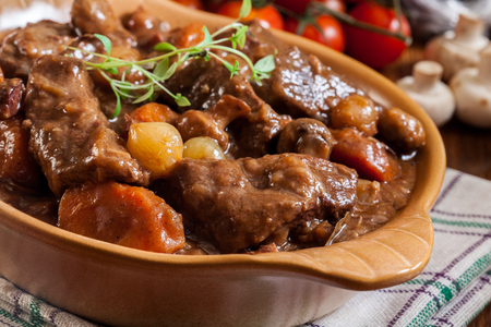 Beef Bourguignon stew served with baguette on dish. French cuisine Stock Photo - 93023565