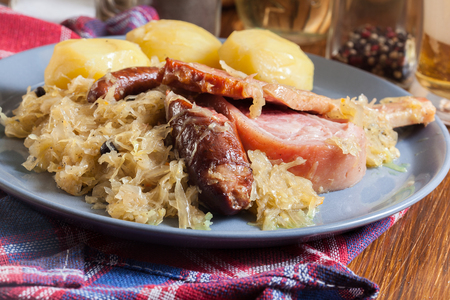 Choucroute garnie. Alsatian sauerkraut with sausages, knuckle and bacon