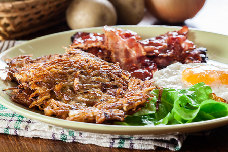 hash browns potato pancakes with crispy fried bacon and fried