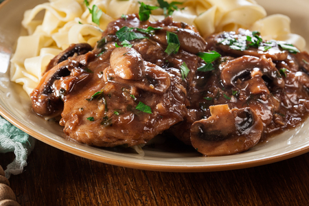 Delicious chicken marsala served with fettucine pasta. Italian cuisine