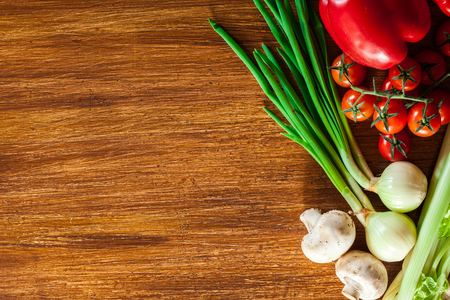 Fresh vegetable borders on wooden background with copy space Stock Photo