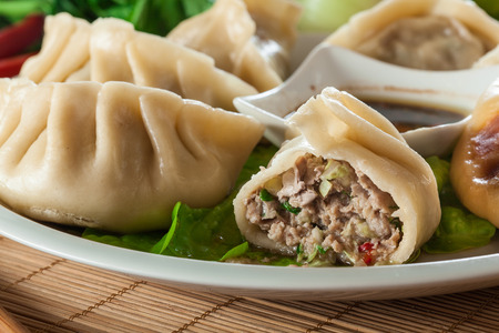 Japanese dumplings - Gyoza with pork meat and vegetables on a plate