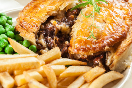Homemade beef stew pie with french fries. Meat in puff pastry Stock fotó