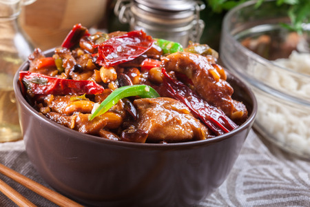 Homemade Kung Pao chicken with peppers and vegetables. Traditional sichuan dish
