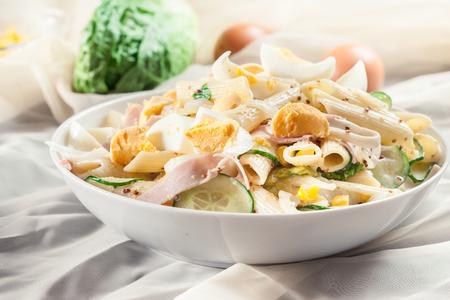 Macaroni salad with ham, cucumber, crab stick, romaine lettuce and mayonnaise