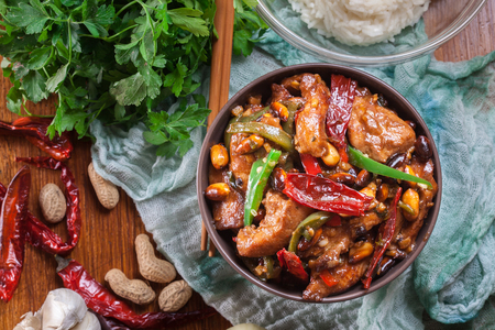 Homemade Kung Pao chicken with peppers and vegetables. Traditional sichuan dish. Top view Stock Photo