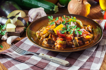 Ratatouille, delicious vegetarian stew. Dish made of zucchini, eggplant, bell peppers, onions, garlic and tomatoes. Traditional french food
