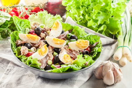 Nicoise Salad with tuna, anchovy, eggs and tomatoes. French dish