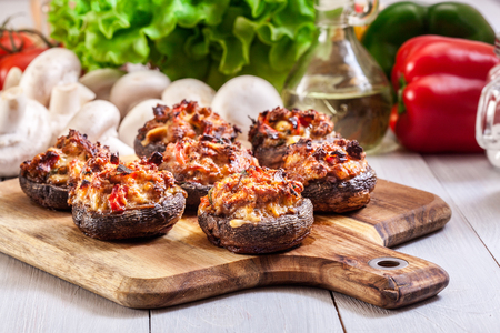 Baked champignon caps stuffed with minced meat, mushroom, paprika and onion