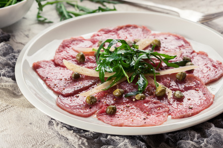 Beef carpaccio with arugula and parmesan. Italian dish Stock fotó