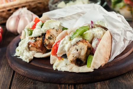 Gyros souvlaki wrapped in a pita bread with french fries. Greek dish