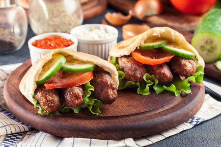 Cevapcici or cevapi served with pita bread and vegetables