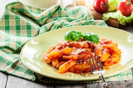 Italian gnocchi with tomato sauce and cheese on a plate