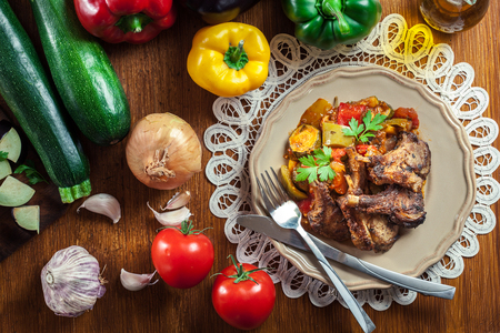 Roasted lamb chops served with ratatouille. Food and drink concept Stock Photo