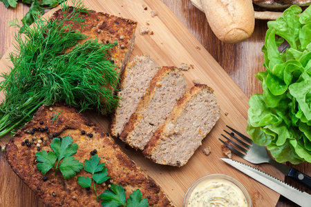 Traditional delicious meat pate with chicken liver on cutting board. Top view Zdjęcie Seryjne
