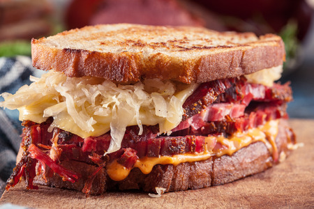 Reuben Sandwich with corned beef, cheese and sauerkraut. Classic New York dish 스톡 콘텐츠