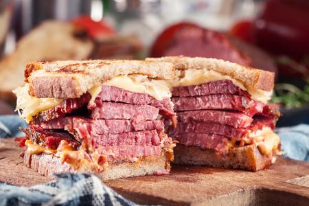 Reuben Sandwich with corned beef, cheese and sauerkraut. Classic New York dish Stock Photo